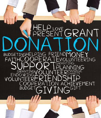 word cloud: Photo of business hands holding blackboard and writing DONATION concept
