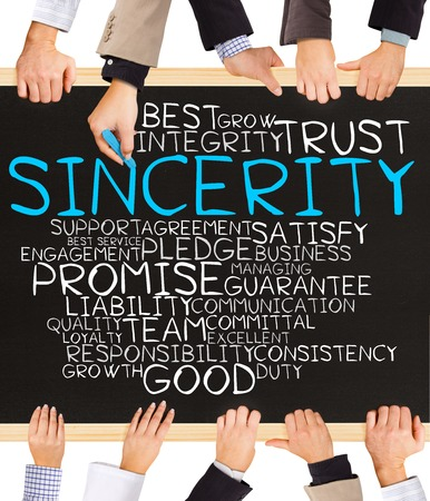 sincerity: Photo of business hands holding blackboard and writing SINCERITY word cloud