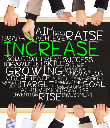 increase business: Photo of business hands holding blackboard and writing INCREASE word cloud