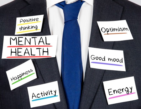 Photo of business suit and tie with MENTAL HEALTH concept paper cards