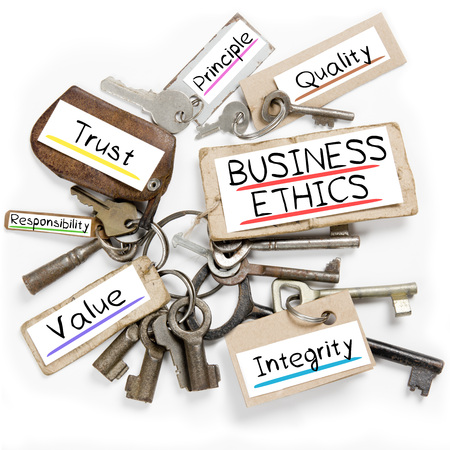 valores morales: Photo of key bunch and paper tags with BUSINESS ETHICS conceptual words Foto de archivo