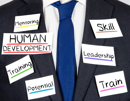 relaciones laborales: Photo of business suit and tie with HUMAN DEVELOPMENT concept paper cards