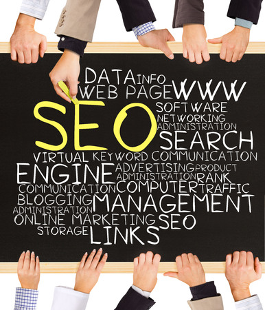 keywords link: Photo of business hands holding blackboard and writing SEO concept