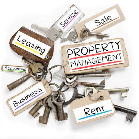 property development: Photo of key bunch and paper tags with PROPERTY MANAGEMENT conceptual words Stock Photo