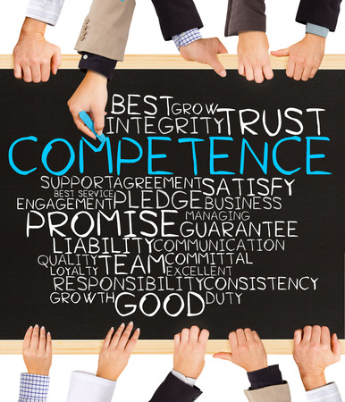 competence: Photo of business hands holding blackboard and writing COMPETENCE concept Stock Photo