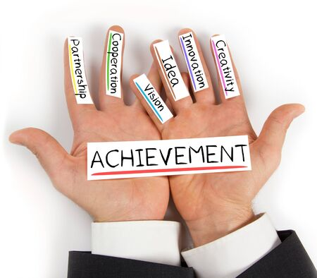 achievement cards: Photo of hands holding paper cards with ACHIEVEMENT concept words Stock Photo