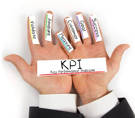 kpi: Photo of hands holding paper cards with KPI concept words