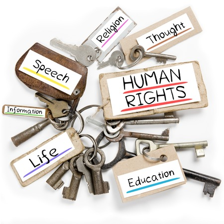 key to freedom: Photo of key bunch and paper tags with HUMAN RIGHTS conceptual words