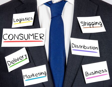 online service: Photo of business suit and tie with CONSUMER conceptual words written on paper cards Stock Photo