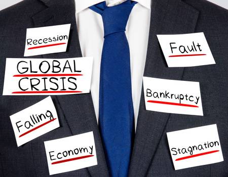global crisis: Photo of business suit and tie with GLOBAL CRISIS conceptual words written on paper cards Stock Photo
