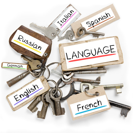 english text: Photo of key bunch and paper tags with LANGUAGE conceptual words