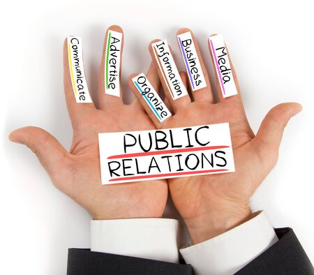 news values: Photo of palms with PUBLIC RELATIONS conceptual words written on paper cards Stock Photo