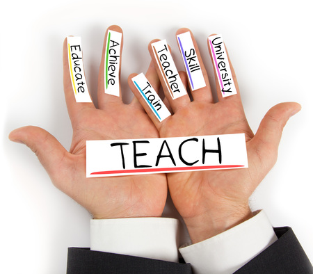 teach: Photo of hands holding paper cards with TEACH concept words