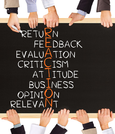 formulate: Photo of business hands holding blackboard and writing REACTION concept