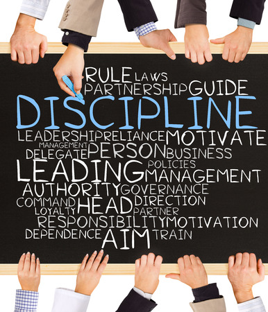 role models: Photo of business hands holding blackboard and writing DISCIPLINE concept Stock Photo