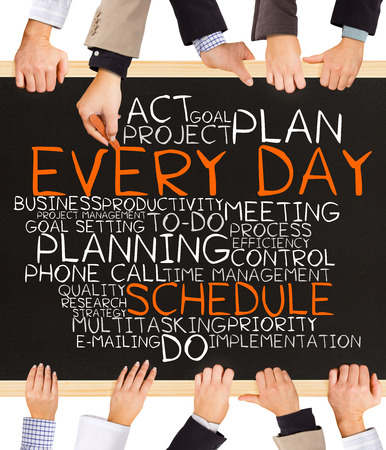 important phone call: Photo of business hands holding blackboard and writing EVERY DAY SCHEDULE concept