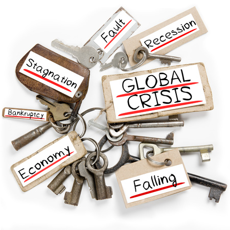 global crisis: Photo of key bunch and paper tags with GLOBAL CRISIS conceptual words