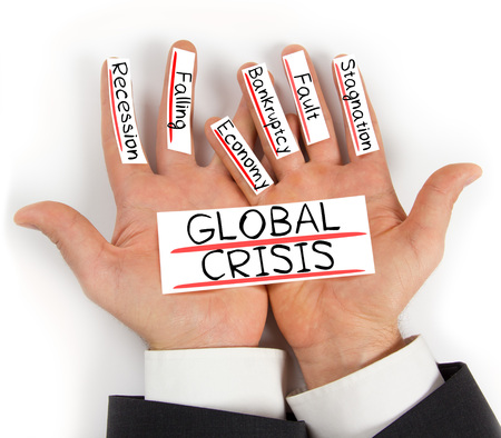 global crisis: Photo of hands holding paper cards with GLOBAL CRISIS concept words