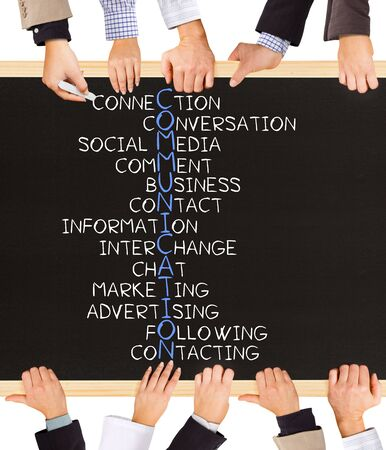 verbal communication: Photo of business hands holding blackboard and writing COMMUNICATION concept