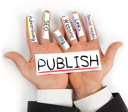 articles: Photo of hands holding PUBLISH paper cards with concept words