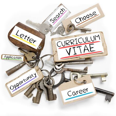 biography: Photo of key bunch and paper tags with CURRICULUM VITAE conceptual words