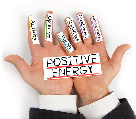 Photo of hands holding POSITIVE ENERGY paper cards with concept words Reklamní fotografie