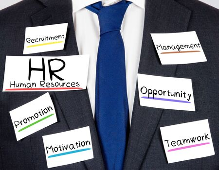 Photo of business suit and tie with HR concept paper cards Stock Photo