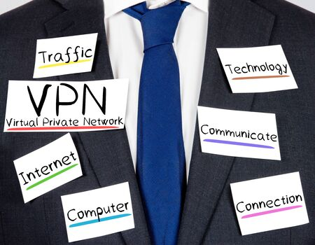 vpn: Photo of business suit and tie with VPN concept paper cards