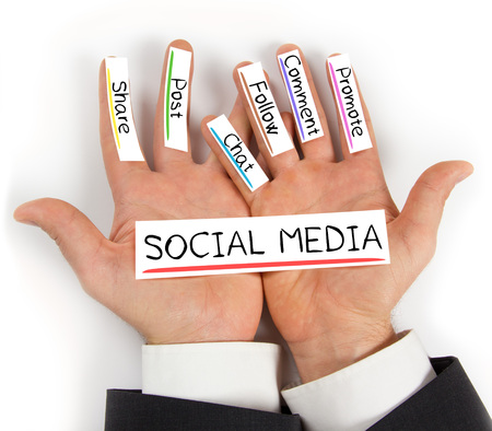 Photo of hands holding paper cards with SOCIAL MEDIA concept words
