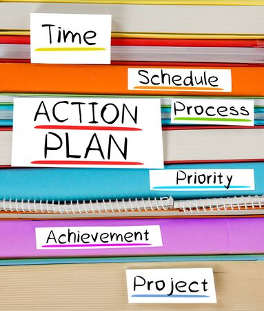 plan de accion: Photo of colorful book stack with bookmarks and labels with ACTION PLAN conceptual words Foto de archivo