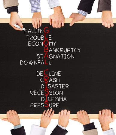 global crisis: Photo of business hands holding blackboard and writing GLOBAL CRISIS concept