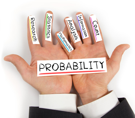 probability: Photo of hands holding paper cards with PROBABILITY concept words Stock Photo