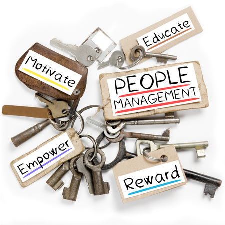 Photo of key bunch and paper tags with PEOPLE MANAGEMENT conceptual words