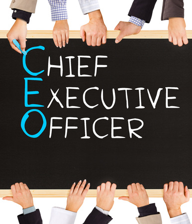 executor: Photo of business hands holding blackboard and writing CEO concept Stock Photo