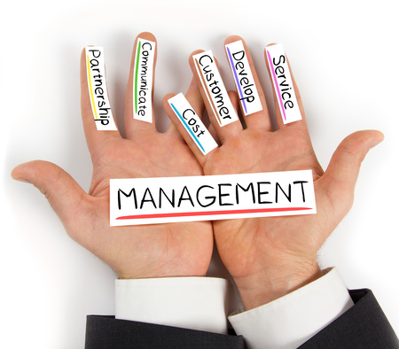 role models: Photo of hands holding paper cards with MANAGEMENT concept words