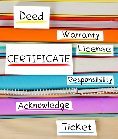 acknowledge: Photo of colorful book stack with bookmarks and labels with CERTIFICATE conceptual words