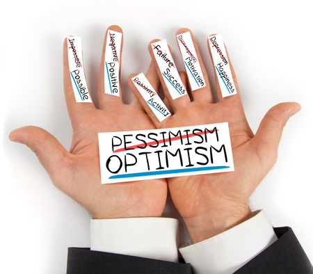 pessimism: Photo of hands holding paper cards with PESSIMISM OPTIMISM concept words