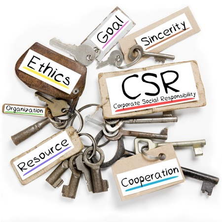 corporate responsibility: Photo of key bunch and paper tags with CSR conceptual words