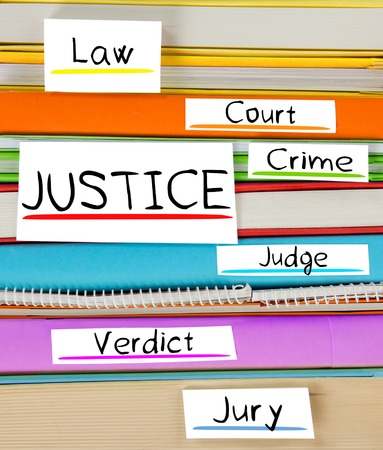 judicature: Photo of colorful book stack with bookmarks and labels with JUSTICE conceptual words