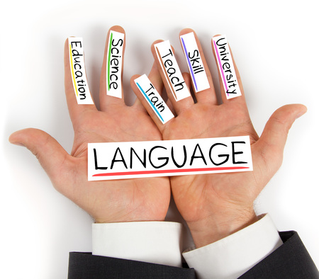 multilingual: Photo of hands holding paper cards with LANGUAGE concept words