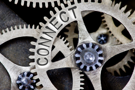 connects: Macro photo of tooth wheel mechanism with CONNECT concept letters