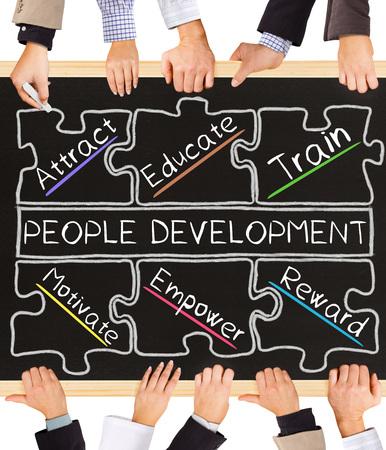 people development: Photo of business hands holding blackboard and writing PEOPLE DEVELOPMENT concept