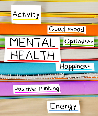 buena salud: Photo of colorful book stack with bookmarks and labels with MENTAL HEALTH conceptual words Foto de archivo
