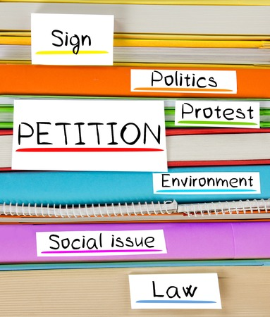 petition: Photo of colorful book stack with bookmarks and labels with PETITION conceptual words