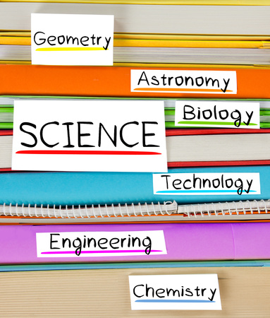 disciplines: Photo of colorful book stack with bookmarks, labels and SCIENCE disciplines