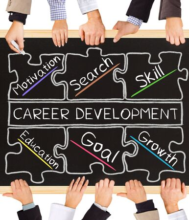 career development: Photo of business hands holding blackboard and writing CAREER DEVELOPMENT concept
