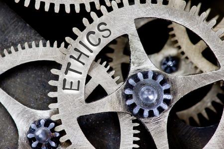 Foto a macroistruzione del meccanismo della ruota dentata con parole di concetto di ETICA