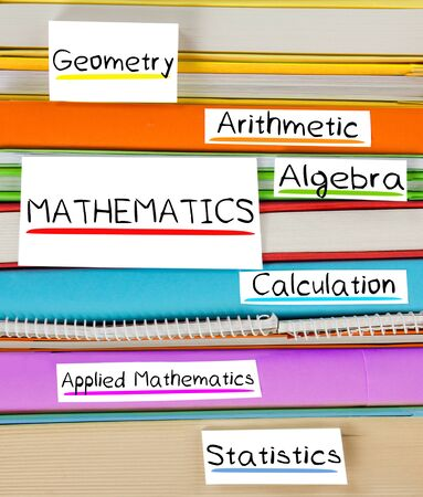disciplines: Photo of colorful book stack with bookmarks, labels and MATHEMATICS disciplines