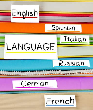 multilingual: Photo of colorful book stack with bookmarks and labels with LANGUAGE conceptual words