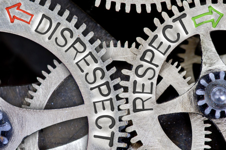 falta de respeto: Macro photo of tooth wheel mechanism with arrows and DISRESPECT, RESPECT letters